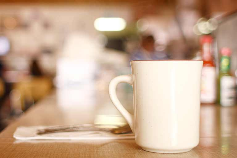 A coffee cup on the counter of a diner