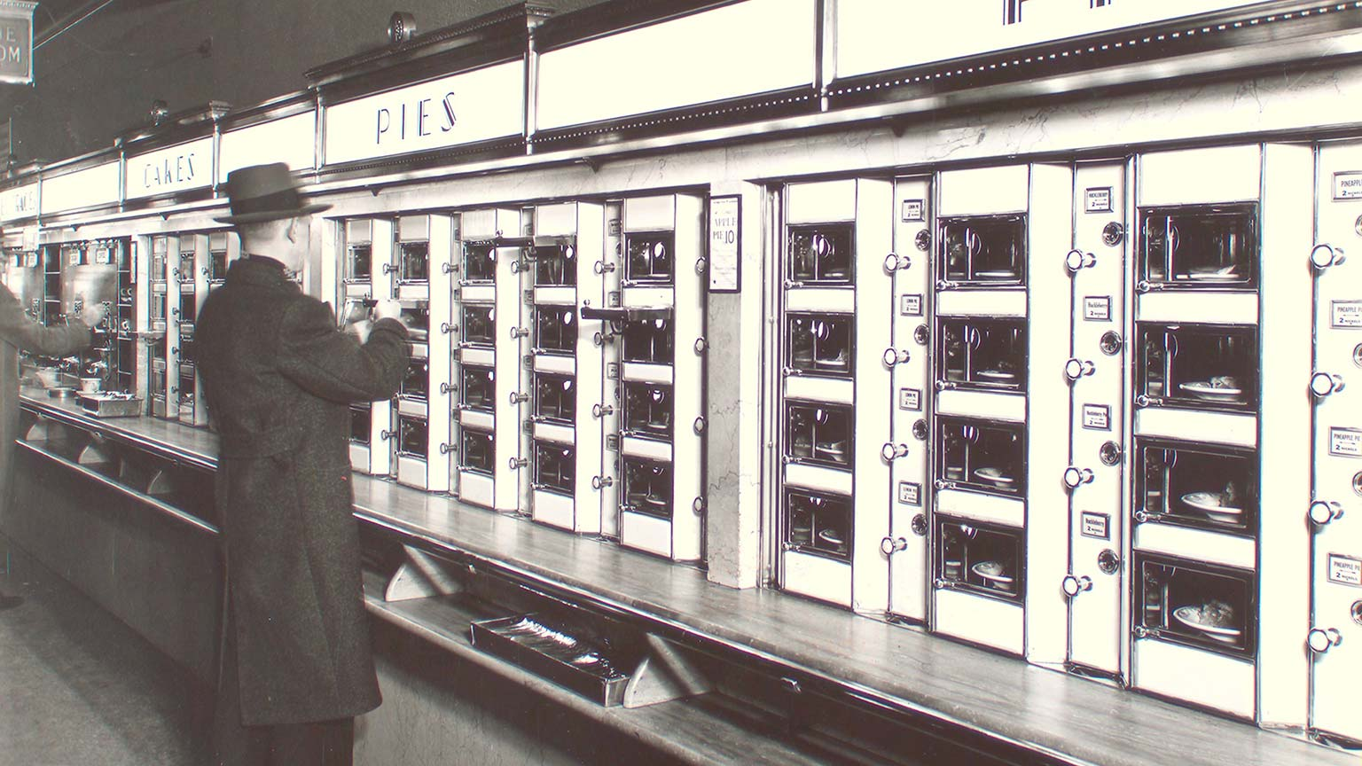 A man standing at an automat