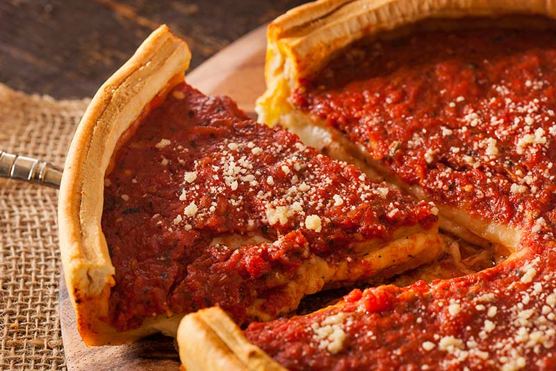 A slice of deep dish pizza