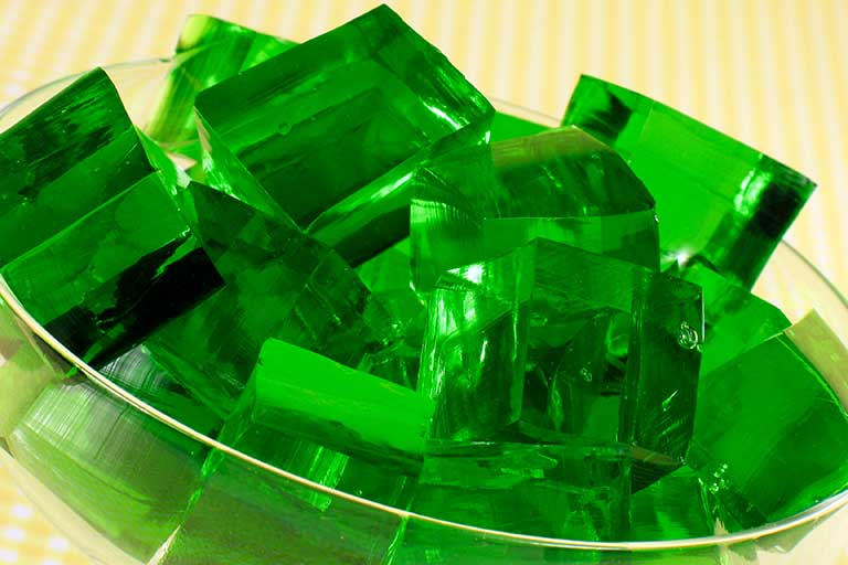 A bowl of green Jell-O cubes