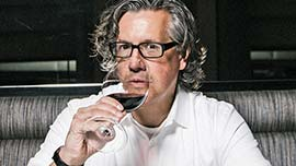 Chef with a glass of wine