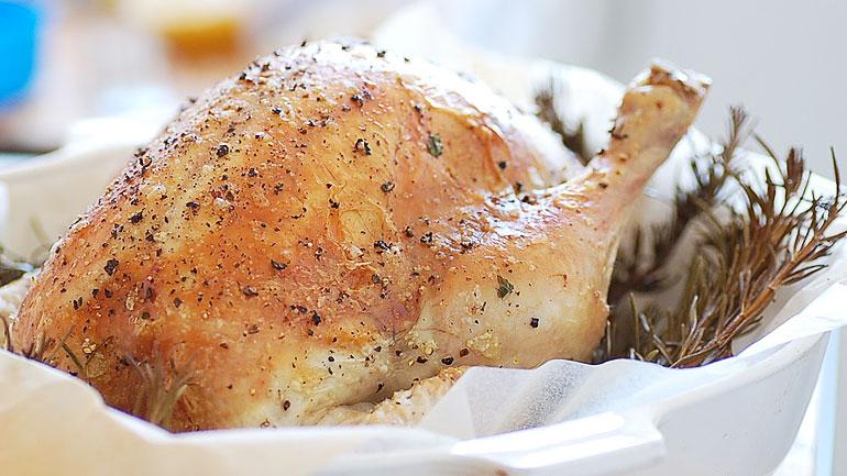 Roasted Chicken stuffed with garlic, rosemary lemon sauce