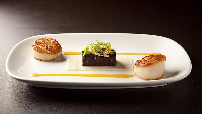 Seared Sea Scallop with Black Pudding, celery, tangerine and almond